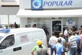 La Policía apresa a tres y persigue a cuatro por asalto al Banco Popular